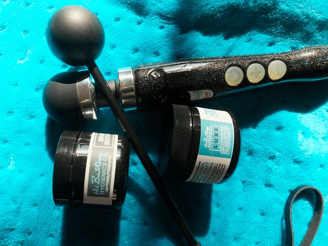 the wand, ball crop, and Butters jars on a heating pad.
